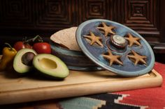 Great for the microwave or oven, this stoneware server will keep your tortillas warm.