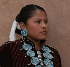 Navajo Woman wearing Zuni style Turquoise cluster jewelry