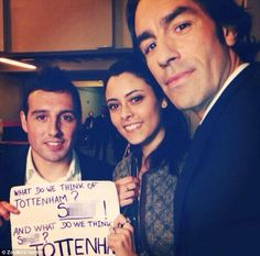 Rivalry: Arsenal midfielder Santi Cazorla (left) and former Gunners star Robert Pires (right) pose with a French fan and her home-made poste...