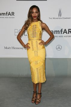 Celebrity Fashion: Hello, Yellow - Slideshow. Also at the amfAR 21st Cinema Against AIDS Gala, Jourdan Dunn proved that yellow can be sexy with her curve-hugging Balmain dress from the house's fall collection. Photo by Tony Barson/FilmMagic