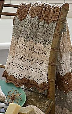 I know, this is knitted, but I like the colors and the lace look. Could duplicate somewhat in crochet. Lacy knitted Blanket in Shades of Brown.
