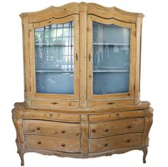19th c. stripped pine cabinet w/ shapely body of drawers & glass door upper
