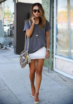 30 Crochet Outfits to Copy This Summer  - Blogger 'Sincerely Jules'  wearing a casual t-shirt, crochet mini skirt, boho bag, + leather sandals | StyleCaster