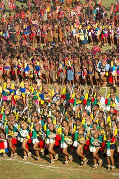 Ludzidzini, Swaziland, Africa - Annual Umhlanga, or reed dance ceremony, in which up to 100,000 young Swazi women gather to celebrate their virginity and honor the queen mother during the 8 day long event.<br /> Maidens dance before King Mswati III on day 7 of the ceremony