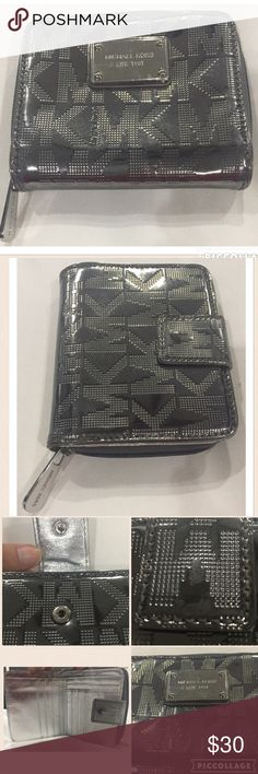 Michael Kors Jet Set Silver bifold wallet Gently used. Shows minor signs of wear. Michael Kors Jet Set Silver bifold wallet - chrome mirrored look, bifold closure and zipper coin purse, 6 slots for credit cards and ID, 4 larger additional slots, plus large top slot for cash. No photo slot. Michael Kors Bags Wallets