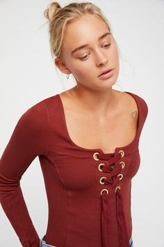 Looking Back Top   Stretchy top featuring chiffon lace-up detailing on the bust with oversized metal grommets.  * Square neckline * Long sleeves * Rounded hem * Ribbed trim