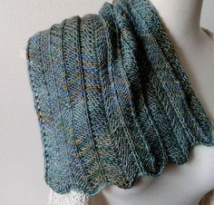 The One Row Chevron Scarf is a reversible take on classic chevron stitches. It knits up in just one pattern row (if you'll excuse the setup rows; it has those too). This lighter sister to Feather is a good travel companion; the concise pattern and lighter yarn make this a more portable project.