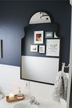 love this bathroom makeover.. Mirror is awesome!