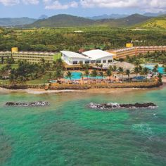 I WISH IT WAS DECEMBER 2013!!!  Set on the silvery south coast of St Lucia, Coconut Bay Resort & Spa is based across 85 glorious acres of palm-fringed gardens. The resort is separated into two wings; one for adults only, the other for families