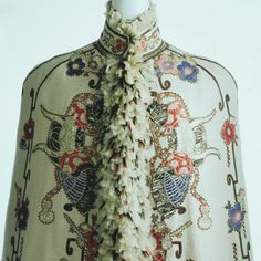 1890-France, a garment called a Visite, made from off-white cashmere, has floral and butterfly motifs, has feathers on the front, KCI Digital Archives