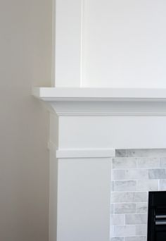 Home Decoration Ideas Lights Fireplace Makeover AFTER - White Painted Fireplace Mantel with Marble Subway Tile Surround Decoration Ideas Lights Fireplace Makeover AFTER - White Painted Fireplace Mantel with Marble Subway Tile Surround Painted Fireplace Mantels, Farmhouse Fireplace Mantels, Marble Fireplace Surround, Build A Fireplace, Slate Fireplace, Fireplace Bookshelves, Paint Fireplace, Brick Fireplace Makeover, Freestanding Fireplace