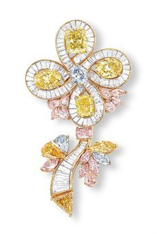 A COLOURED DIAMOND FLOWER BROOCH/PENDANT  Centering upon an oval-shaped light grayish-blue diamond weighing 0.92 carat, extending four intense yellow pear shaped diamonds, various pink and orange coloured diamonds; all natural coloured; length 4.5 cm with pendant attachement.  Via Christie's; sale price $150,105.