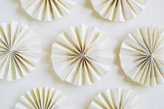 Create a paper fan backdrop for your 4th of July party! | via Spark & Chemistry