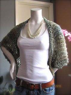 crochet shrug. Shawl pattern with tips attached to form sleeves?