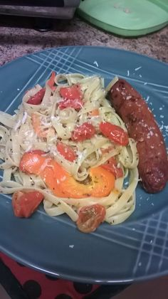 Italian home-made dinner.  Pre-heat oven to 200F. Slice orange bell pepper into strips and halve cherry tomatoes. Place on baking sheet with olive oil, salt, and pepper. Bake in oven for an hour or longer to draw out natural sweet flavors.  Cook fettuccine noodles (or others of your choice). Toss with olive oil, basil, oregano, salt, pepper, and Parmesan cheese. Add in roasted vegetables for very delicious and simple dish. Serve with protein of your choice.