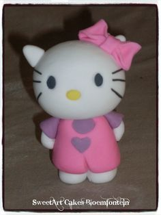 FONDANT HELLO KITTY CAKE TOPPER (8cm standing / 6cm sitting) @ R70 each (All figurines contain Tylose which preserves the figurine for an indefinite period of time) For more information & orders email SweetArtBfn@gmail.com or Call Lola 0712127786. Hello Kitty Cake, Fondant Figures, Edible Cake, Cupcake Toppers, Preserves, Period, Cake Decorating, Cakes, Facebook