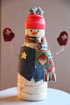 Creamer Bottle Snowman - predecorate simply and have kids fill with mini marshmallows and add finishing touches at school party?