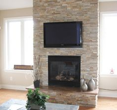 Elegant Modern Family Room Design Interior Used Stone Fireplace Design and Small Shaped Decoration Ideas Reface Brick Fireplace, Stone Veneer Fireplace, Stone Fireplace Designs, Tv Above Fireplace, Natural Stone Fireplaces, Fireplace Redo, Rock Fireplaces, Fireplace Remodel, Fireplace Ideas