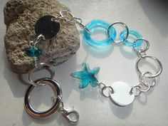 Sea inspired bracelet - featuring aqua blue fused rings & swarovski crystal starfish - a summer favorite!  $21
