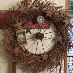 Rusty Wheel Inside a Grapevine Wreath Wrapped in Rusty Stars
