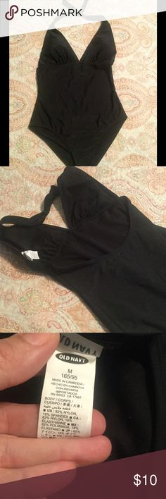Old Navy swimsuit, size medium Classic black old navy one piece halter swimming suit. Tie back on neck.  Excellent used condition.  No snags, piling, etc. Old Navy Swim One Pieces