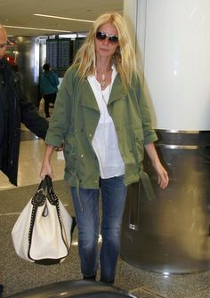 Gwyneth Paltrow The GOOP creator and actress keeps it casual and cool with a loose basic army jacket. Her straw Gucci tote makes the perfect travel carryall at the airport in LA.