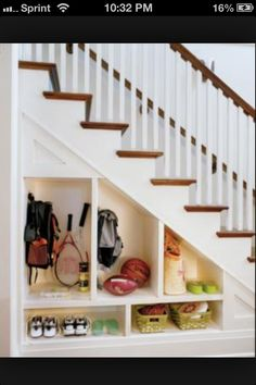 Under Stairs Closet Systems   Foyer under stairs shelves cabinets   Design ideas