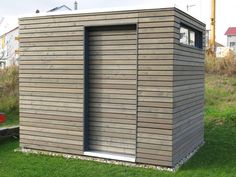 DIY: Gartenhütte DIY garden shed with closed rhombic cladding, sliding door, window, flat roof with roof drain and floor hatch for water and electricity connection