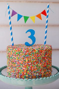 4 layer freckle cake with hundreds and thousands. Cake bunting set made to post…