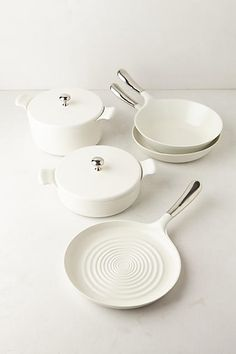 Simple, White Ceramic-Coated Cookware (Ceramic-coated, heavy-gauge cast aluminum, stainless steel)