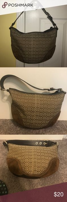Coach Soho Mini Signature Hobo Coach brown signature mini hobo purse. In good condition. The only flaw is a large stain on the bottom of the purse where there is suede. The picture shows the stain. Coach Bags Hobos