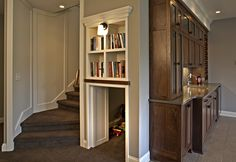 Small panels under the bookcase hide the entrance to this secret room.