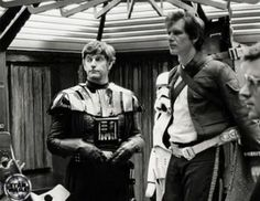 David Prowse as Darth Vader with Harrison Ford as Han Solo behind the scenes on #StarWars Episode V (1980)