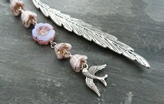 This pretty feather shaped bookmark has been decorated with flowery beads in a delicate shade of lilac. A small bird charm hangs beneath the beads. The main body of this bookmark measures It will arrive tissue wrapped and placed in an organz. Lilac Flowers, Beaded Flowers, Organza Gift Bags, Small Birds, Bookmarks, Feather, Delicate, Charmed, Beads