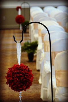 Line the aisle with pomander balls. Use dark red carnations, white hypericum, and Israeli ruscus. (Pomander Balls by LoveAlwaysWhitney on Etsy, $25.00)
