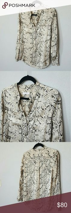 """Equipment Silk Snake Print Blouse *EUC, no signs of wear*  Ultra smooth silk charmeuse fabric Popover style Mandarin collar One button cuffs Long sleeve Double breast pockets Single back pleat 28"""" Shoulder to hem 19"""" Across bust Statement-making print in versatile neutral palette  No trades, just selling. Thank you! Equipment Tops"""