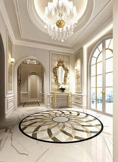 Traditional entryway with stuning marble tile floors, amazing chadelier and a bespoke golden wall mirror. ➤ Discover the season's newest designs and inspirations. Visit us at http://www.wallmirrors.eu #wallmirrors #wallmirrorideas #uniquemirrors @WallMirrorsBlog