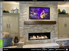 Framed TV , rustic mantel over linear fireplace