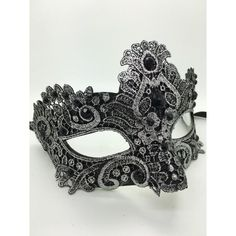 Silver and Black Mardi Gras mask with lace and ribbon ties.