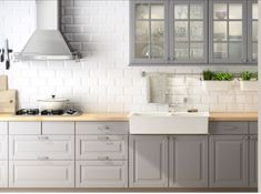 This is more or less what we will have: the grey cabinets, but still not sure about the counter #top if we will have wood or stone... We do want the white subway tiles with white grout.