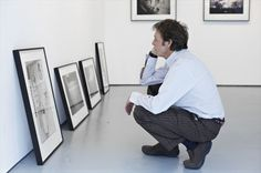 Paul McCartney looking over photography by his late wife Linda, such a touching image, what a loving expression :)