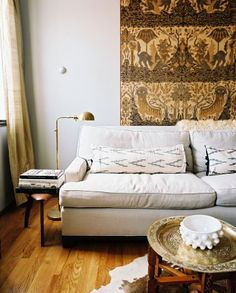 Scout Designs NYC - living rooms - ethnic, wall tapestry, oatmeal, linen, sofa, West Elm, ikat, lumbar, pillow, gold, tray, Moroccan, table, moroccan table, moroccan coffee table, moroccan tray table, moroccan brass tray table,