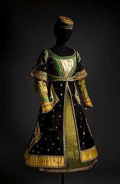 Léon BAKST  designer Belarus (Russia) 1866 – France 1924  France from 1912    Paris  France producer 1909 – 1929    Marie MUELLE  costumier France      Costume for a friend of Queen Thamar c.1912  dress: silk, silk and cotton lining, cellulose diacetate, paint, viscose, silk ribbon, metallic braid, metal pressed shapes; hat: cotton, silk/cotton satin, mtallic braid  Purchased 1976  National Gallery of Australia, Canberra  NGA 1976.1054.755.A-B