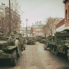 the_ww2_memoirs American GIs from the HQ Company belonging to the 526th Armored Infantry Battalion, prepare to move out towards the frontline with their M-3 half tracks and Dodge WC-63 parked in Rue de la Gare in Malmedy, Belgium, mid-December, 1944. On December 16th, 1944, Joachim Piper captured almost a 100 American soldiers near Malmedy. The soldiers under his command in the 9th SS Panzer Division went to the outskirts of the town and lined the prisoners in a snowy pasture feet away from…