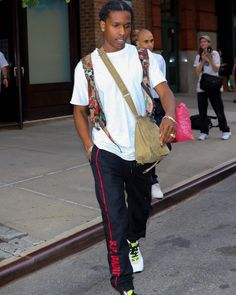 ASAP Rocky Seen In NYC Wearing S.P. Badu Track Pants And Dior Homme Sneakers