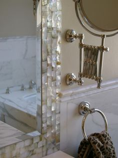 """This project was designed by lisa rubenstein - real rooms design. The mother of pearl tiles surrounding the mirror reflect the simplicity, natural beauty. The designer shows her delicate thoughts in applying this materials. Mother of pearl tiles, as one of the best sellers on BuilderElements.com, are on sales. Enter pinterest member ONLY discount code """"pinbe.com"""" in your check out process to get 15% discount. http://www.builderelements.com/tile/mosaic-tile/mother-of-pearl-tile.html"""