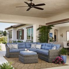 This new set features all-weather wicker with the look and feel of natural seagrass.  The blue cushions and eclectic pillows make this set both relaxed and sophisticated.   Garden Ridge 4pc Seating Set by Mission Hills