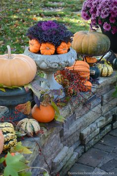 Fall color with pumpkins, mums and kale on stone wall | homeiswheretheboatis.net