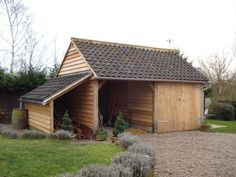 Timber garage, carport and woodshed together. More information about timber garages and other wooden buildings at quick-garden.co.uk/wooden-garages-aluminum-carports.html