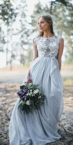 Gorgeous sleeveless floral embroidered bodice wedding dress with effortless blue skirt; Featured Dress: CarouselFashion